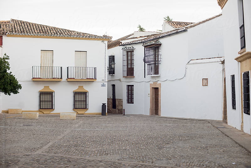 A Spanish plaza surrounded by white walls. by Mike Marlowe for Stocksy United
