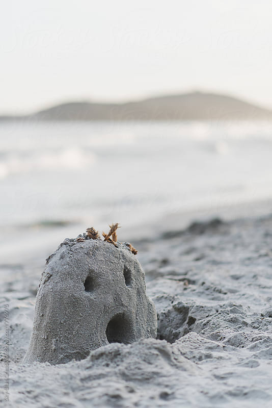 Little sand ghost on the beach by Luca Pierro for Stocksy United