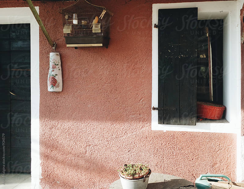 A window and a door of a small italian village house by Anna Malgina for Stocksy United