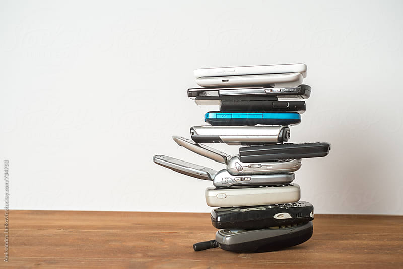 Stacked Mobile Phones from the Oldest to the Newest by Aleksandra Jankovic for Stocksy United