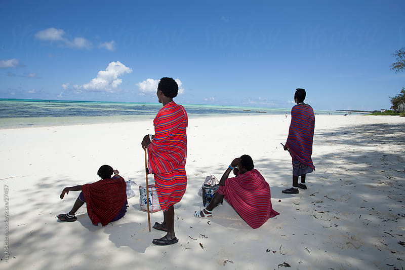 Maasai tribesmen on Zanzibar beach. Tanzania by Hugh Sitton for Stocksy United
