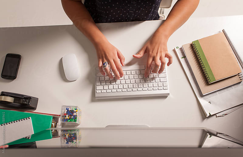 Woman Typing on a Computer Keyboard by Mosuno for Stocksy United
