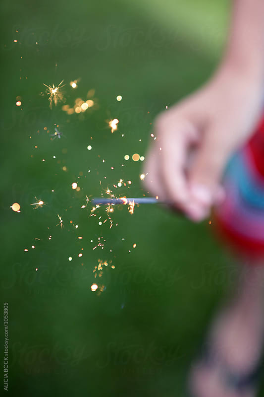 A Child's Hand Holding A Sparkler On A Summer Night by ALICIA BOCK for Stocksy United
