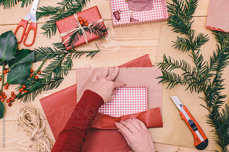 Woman wrapping Christmas gifts by michela ravasio for Stocksy United