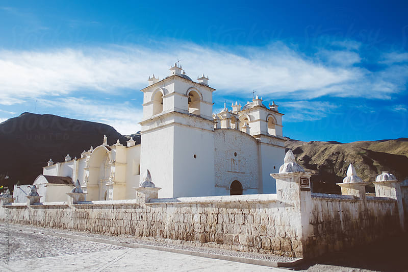 Beautiful colonial white stone church in Yanque, Peru by Adrian Seah for Stocksy United