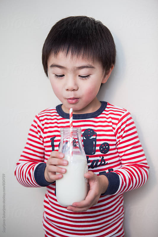 Cute Asian boy drinking milk by Suprijono Suharjoto for Stocksy United