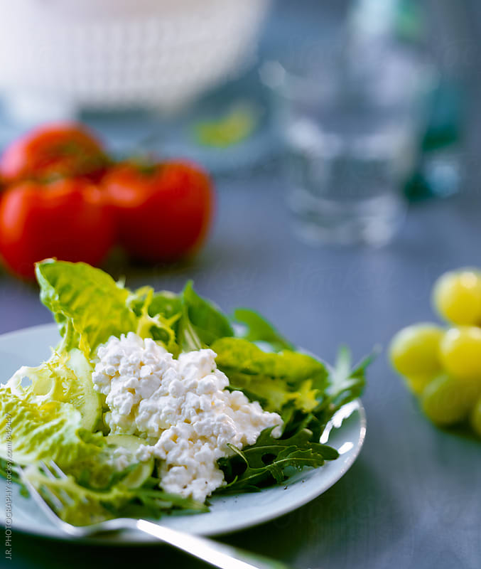 Cottage cheese with lettuce by J.R. PHOTOGRAPHY for Stocksy United