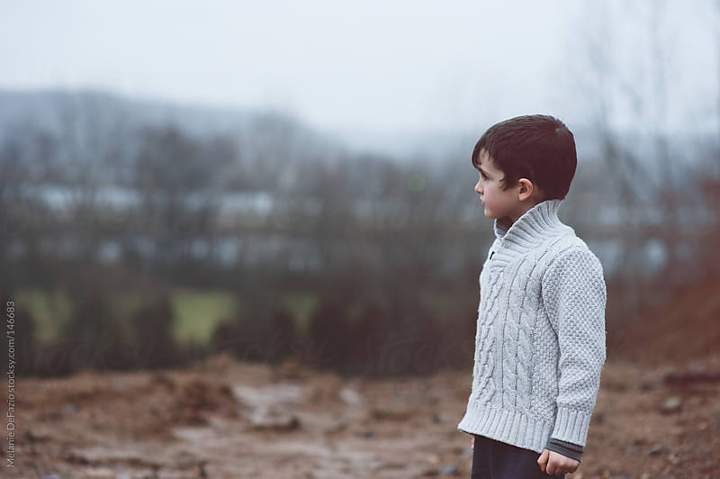 Young boy by Melanie DeFazio for Stocksy United