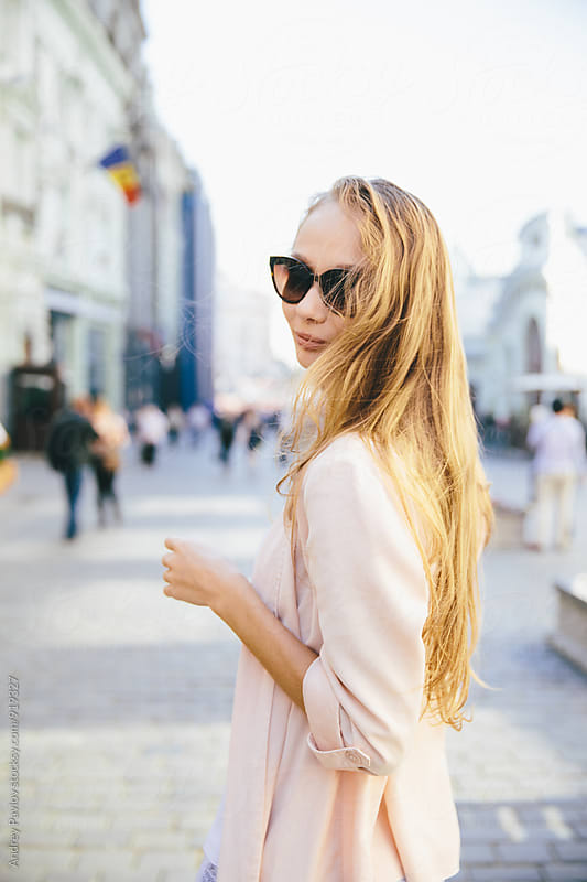 Young blonde woman in sunglasses by Andrey Pavlov for Stocksy United