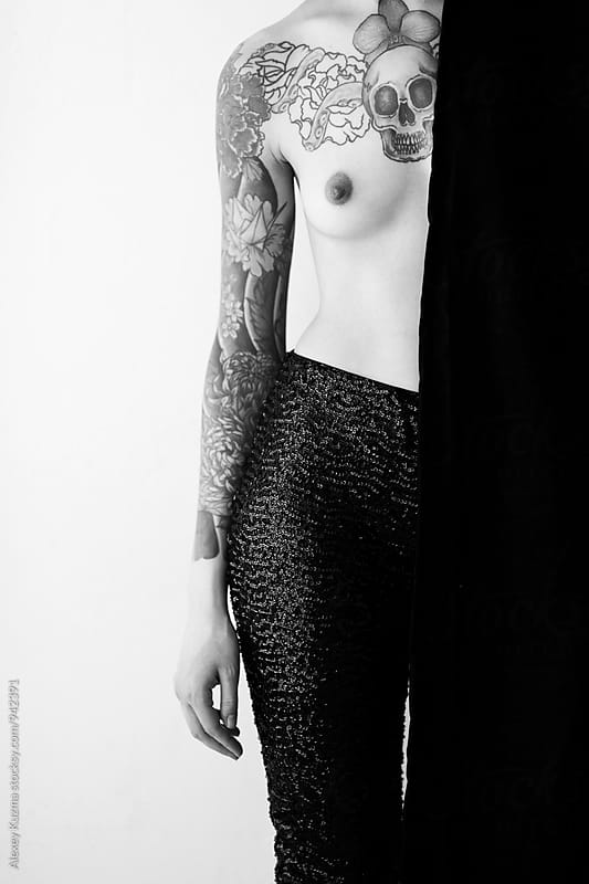 topless young woman with tattoo  by Alexey Kuzma for Stocksy United