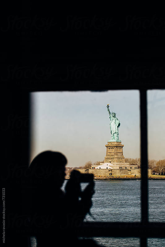 Statue of Liberty view from the window of the ferry by michela ravasio for Stocksy United