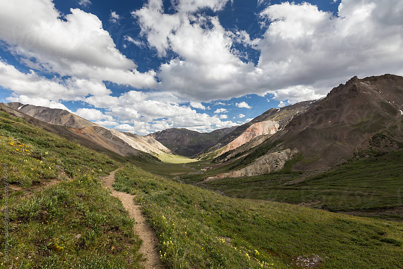 Hiking trail in green mountain valley during summer by Matthew Spaulding for Stocksy United