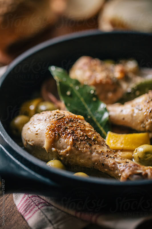 Roast chicken with lemon and olives by Davide Illini for Stocksy United