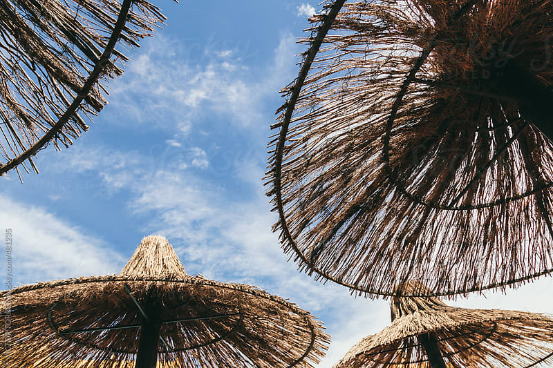 Straw Umbrellas Background by VICTOR TORRES for Stocksy United