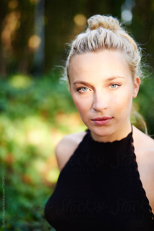 sweet blonde woman with green eyes by Guille Faingold for Stocksy United