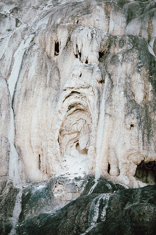 A Ghoulish Face With Gaping Mouth In Rock Wall by Luke Mattson for Stocksy United
