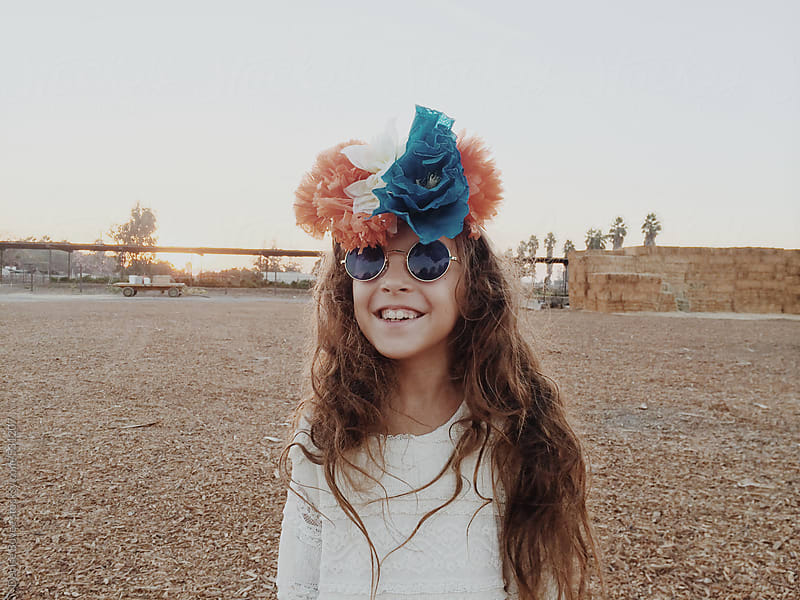 Young Girl Wearing Flower Crown and Sunglasses by Denise Bovee for Stocksy United