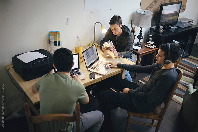 Architecture Students Discussing Structural and Computer Generated Models at Home by Joselito Briones for Stocksy United