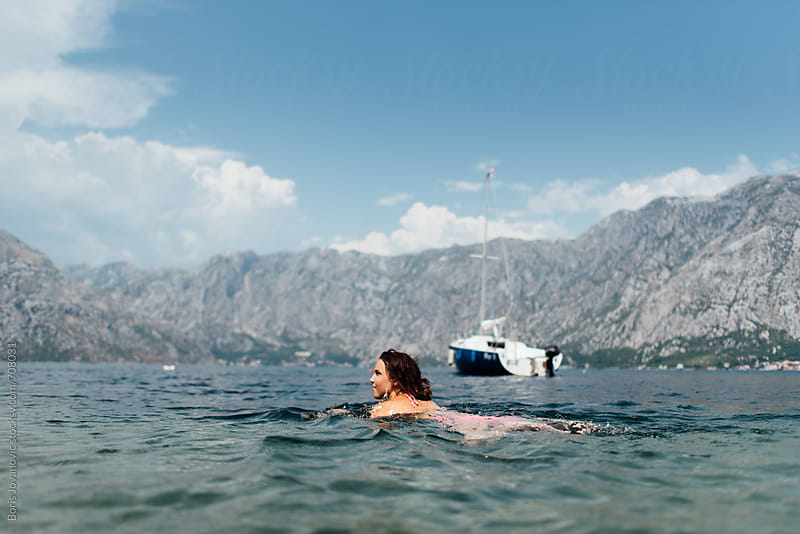 Woman swimming in the sea by Boris Jovanovic for Stocksy United