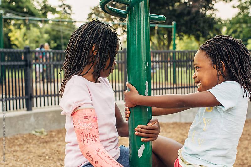 Two black girls playing in a park by Gabriel (Gabi) Bucataru for Stocksy United