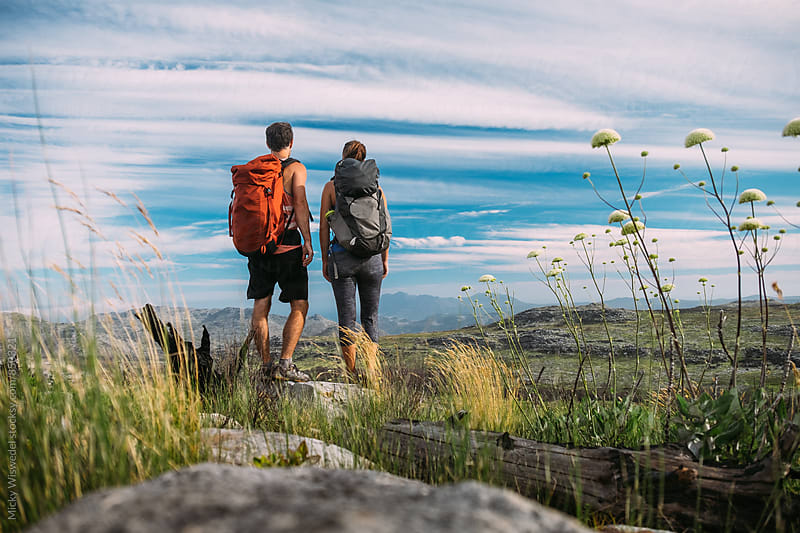 Hiking couple in the mountains enjoying a scenic view by Micky Wiswedel for Stocksy United