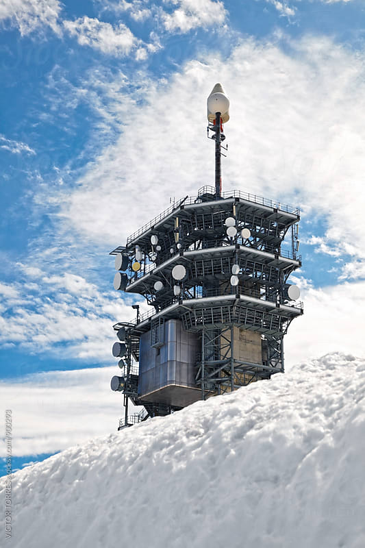 Telecommunication Tower in the snow by Victor Torres for Stocksy United