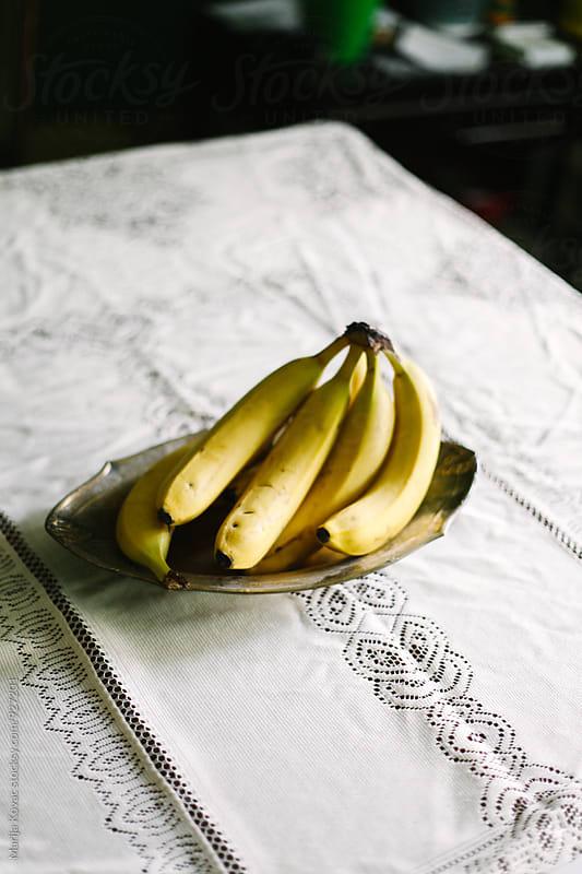 Bananas in a bowl by Marija Kovac for Stocksy United
