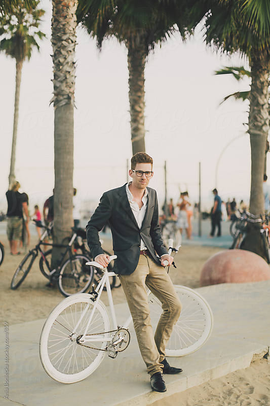 Man and his bike by Ania Boniecka for Stocksy United