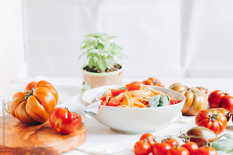 Italian pasta with tomatoes and basil by Nataša Mandić for Stocksy United