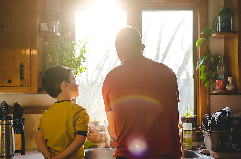 Father and  young son cleaning the kitchen sink by Lindsay Crandall for Stocksy United