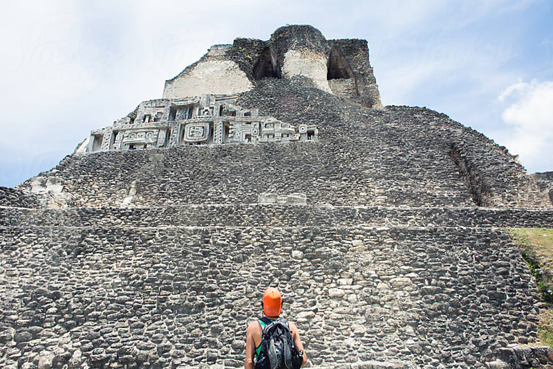 Man Looking Up at Ancient Mayan Temple by MEGHAN PINSONNEAULT for Stocksy United