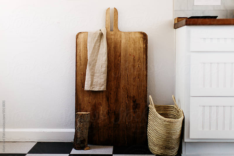 Large cutting board against white wall by Matt and Tish for Stocksy United