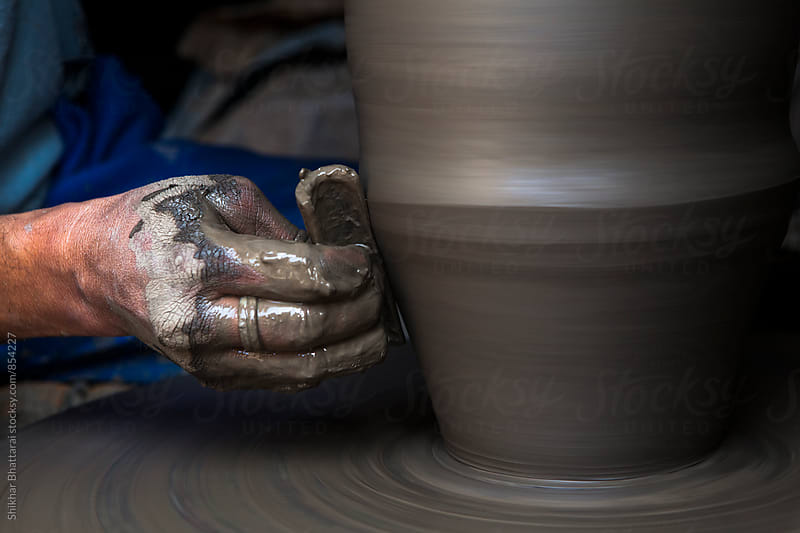 Details of hands making pottery. by Shikhar Bhattarai for Stocksy United