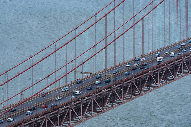 Car Traffic on a Suspension Bridge by Tom Uhlenberg for Stocksy United