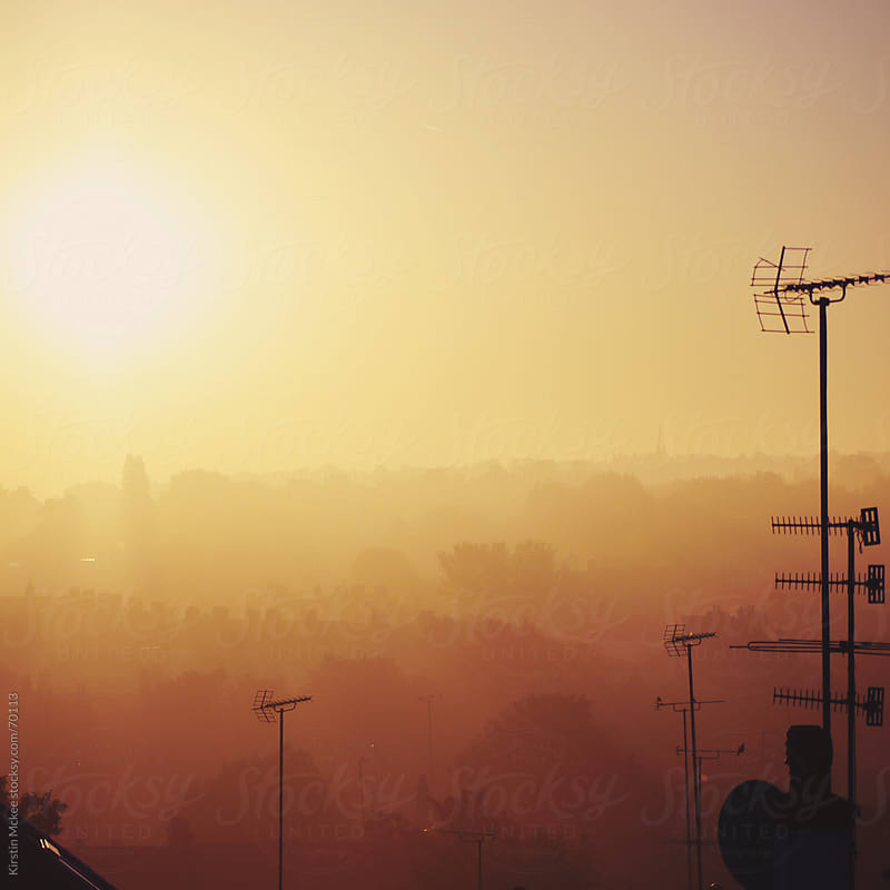 Sunrise over the roofs of London by Kirstin Mckee for Stocksy United
