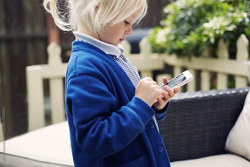 School child using a smart phone by sally anscombe for Stocksy United