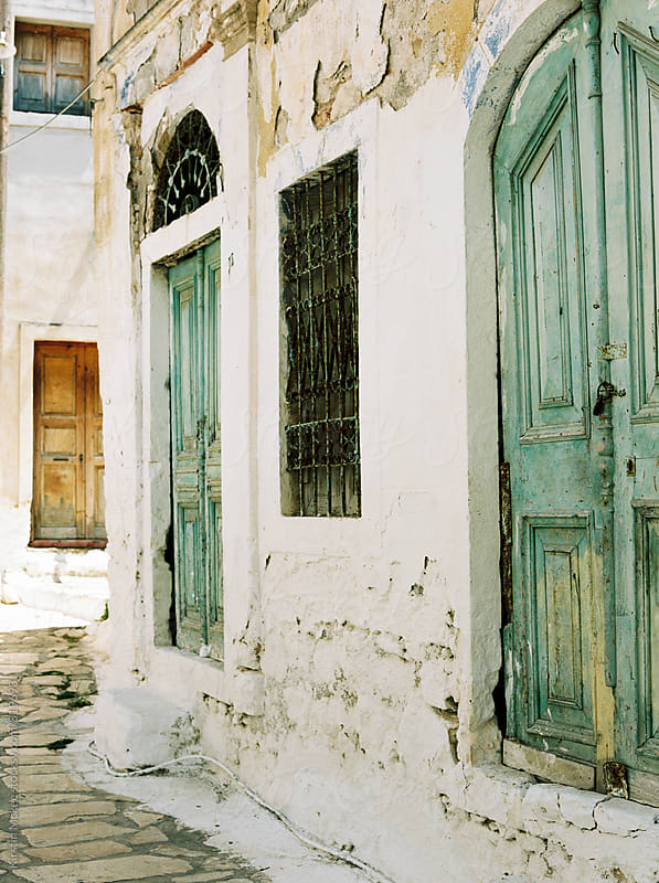 Traditional doors in Kastellorizo, Greece by Kirstin Mckee for Stocksy United