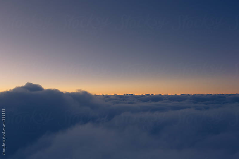 above the cloud by zheng long for Stocksy United
