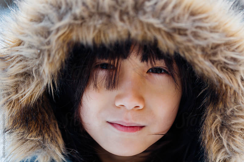 Cute Mixed Race Boy in Winter Hat Looking At Camera by Kelli Seeger Kim for Stocksy United