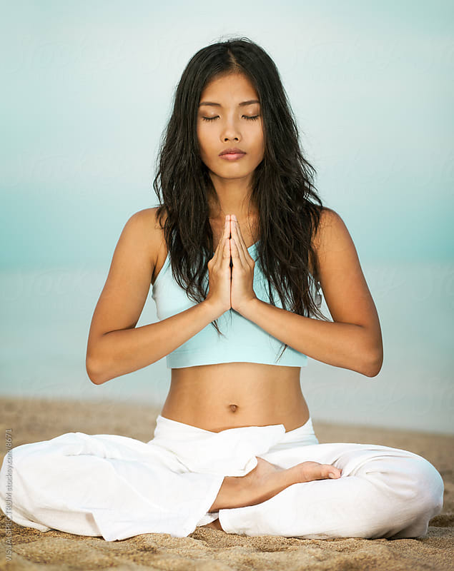 Asian Woman in Prayer Pose on Beach by Julien L. Balmer for Stocksy United