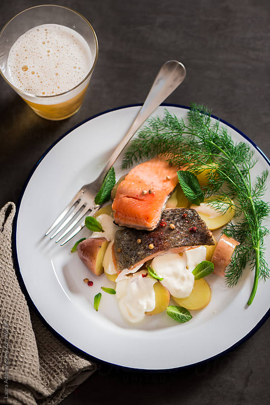 Sauteed fillet of trout with potato salad by Laura Adani for Stocksy United