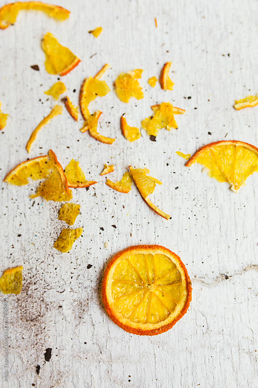 Dry orange slices on a white wooden background by Maja Topcagic for Stocksy United