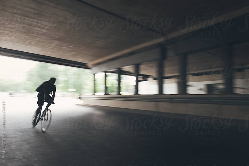 Bicycle Messenger in Tunnel by VISUALSPECTRUM for Stocksy United