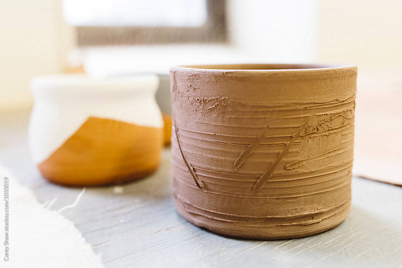Clay mugs with glaze designs by Carey Shaw for Stocksy United