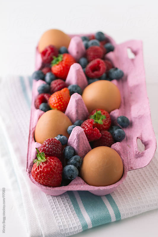 Eggs and Summer Berries complete vertical  by Kirsty Begg for Stocksy United