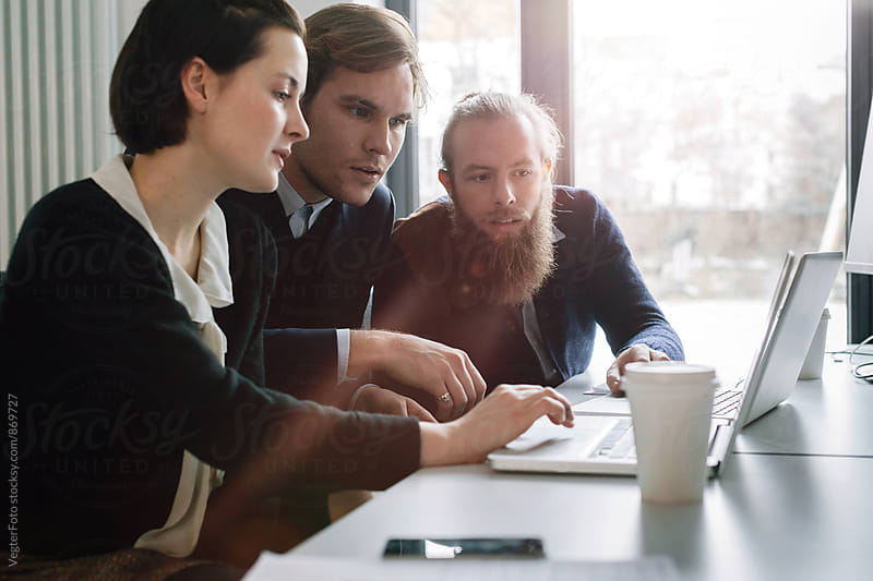 Three Business people discussing business plans by VegterFoto for Stocksy United