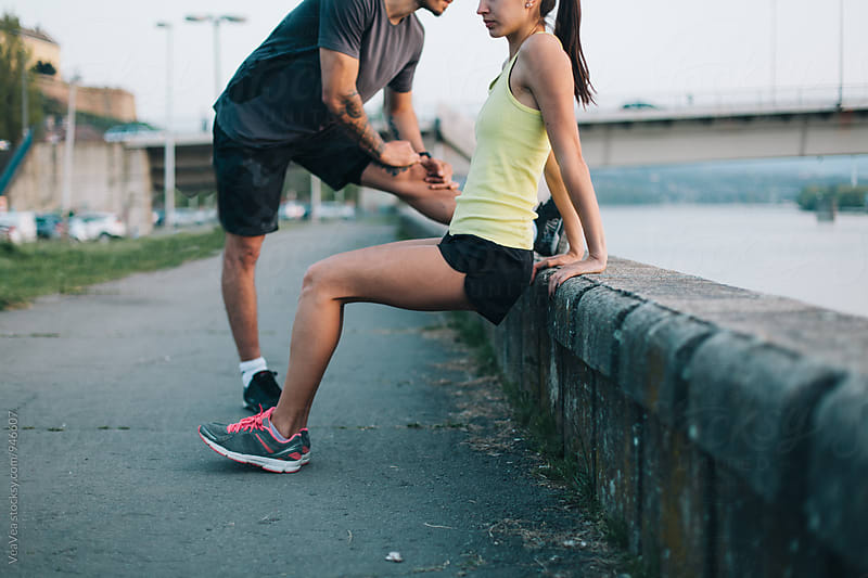 Young couple working out outdoors by VeaVea for Stocksy United