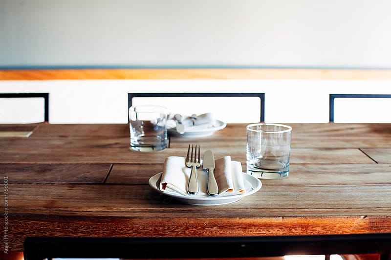 Place Setting on Wooden Table in Urban Restaurant by Anjali Pinto for Stocksy United
