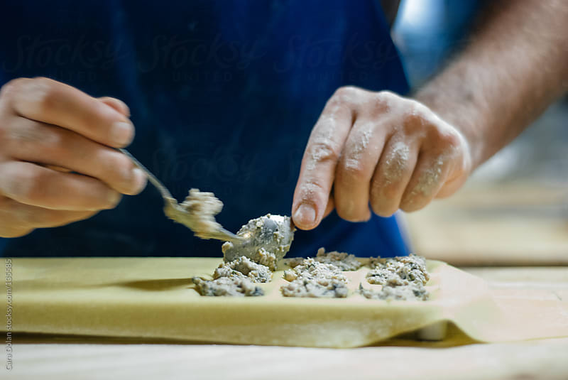 Pasta chef prepares fresh ravioli in a restaurant kitchen by Cara Dolan for Stocksy United