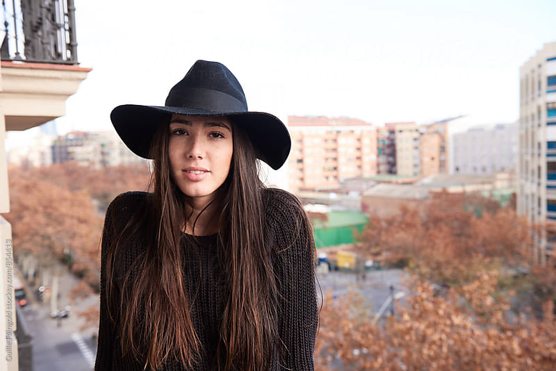 Portrait of beautiful young woman in black hat by Guille Faingold for Stocksy United
